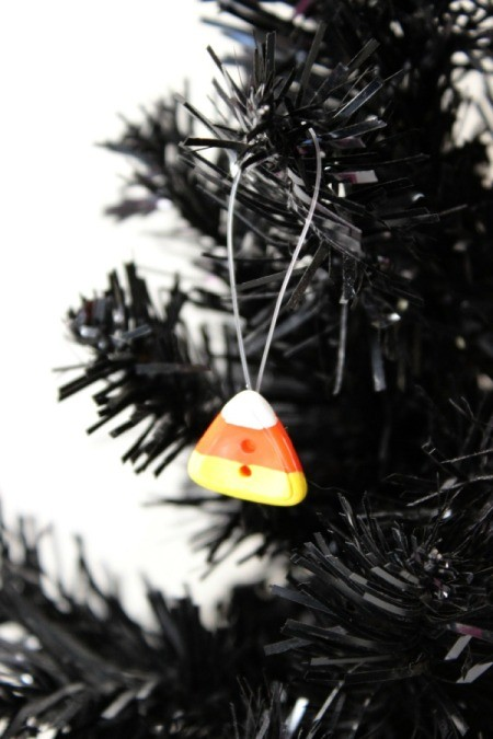 candy corn ornament on tree