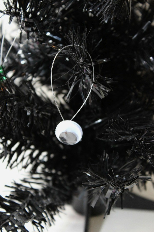 googley eye ornament in tree - Black Halloween Tree