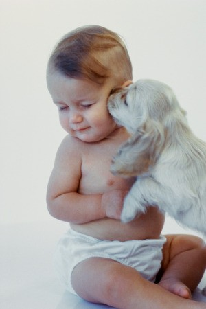 young baby with puppy