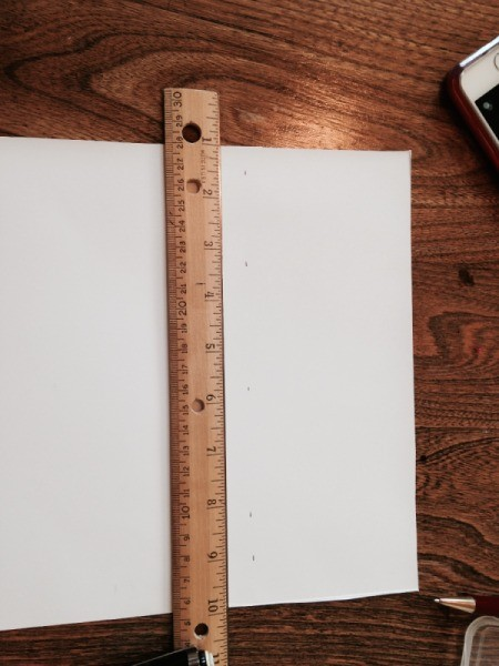 ruler on template paper to draw lines for pattern