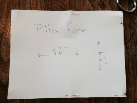 pillow form fabric cut out and still pinned to template