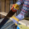 person using a handsaw