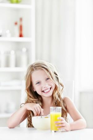 Girl Eating Breakfast Before School