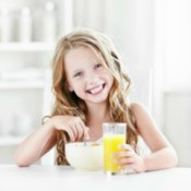 Girl Eating Breakfast Before School