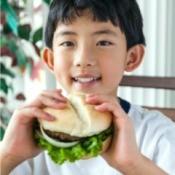 Boy Eating a Burger