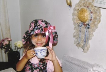 closeup of little girl dressed for a tea party