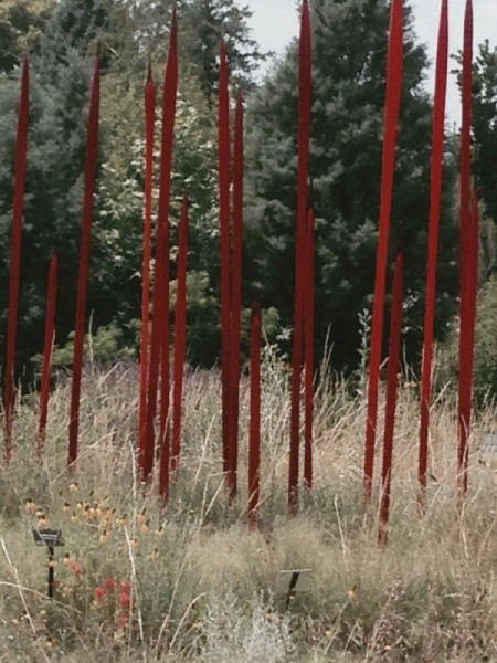 brillant red spears of glass rising up from a prairie setting