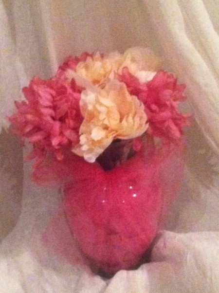 flowers in vase wrapped in bright pink tule