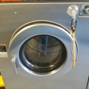 front load washer with bungee cord keeping it open