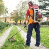 man in orange vest with weed wackier