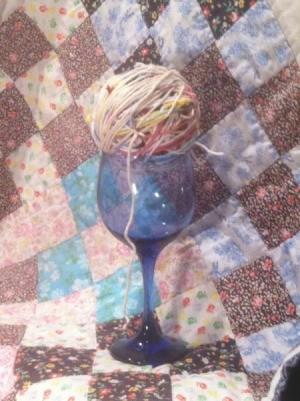 Scrap Yarn Ball - ball of yarn in stem glass