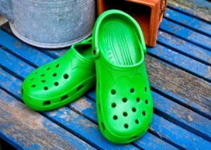 rubber clogs on blue bench