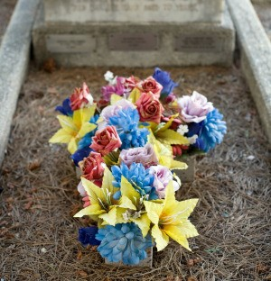 grave cross made of artificial flowers