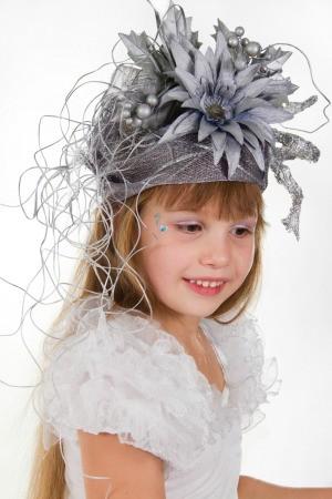 child wearing fancy flowered hat