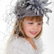 child wearing fancy flowered hat