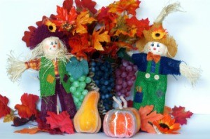 smiling scarecrow and leaves decoration