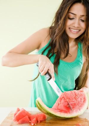 Woman Cutting a Watermelon