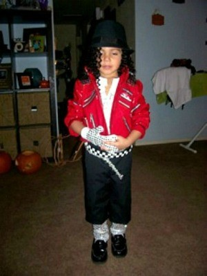 small boy dressed as Michael
