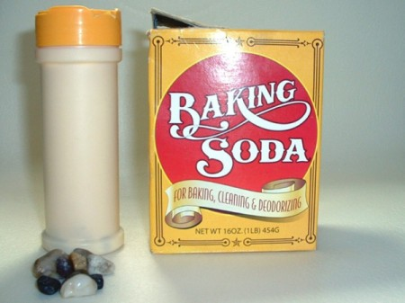 box of baking soda and a spice bottle