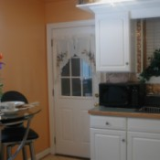view of kitchen with walls, cabinets, and existing countertops