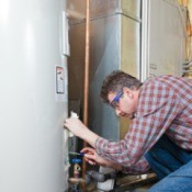 man maintaining a water heater