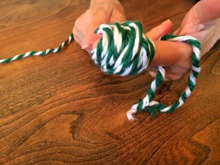 wrap yarn around fingers 2