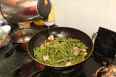add green beans and a little water
