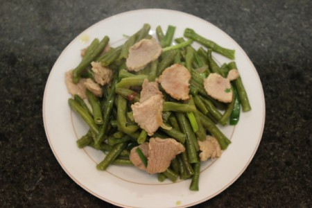 beans and pork on white serving dish