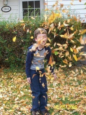 Mike Playing in the Leaves