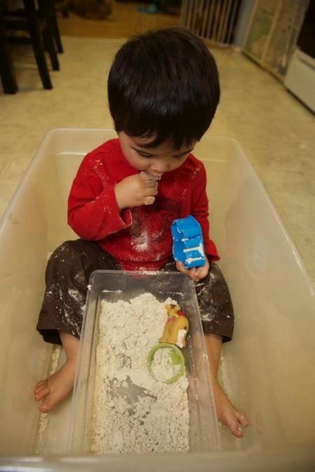 child tasting dough