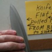 Using a belt to sharpen a knife edge