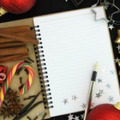 Christmas journal with cookies and cinnamon sticks
