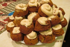 Individual Pumpkin Bundt Cakes - a stack of finished cakes on a plate.