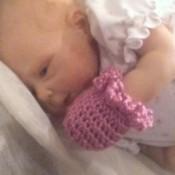 final photo of baby wearing a mitt