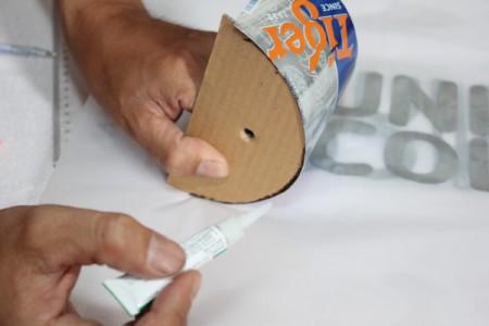gluing cardboard to can