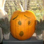 pumpkin with painted on face