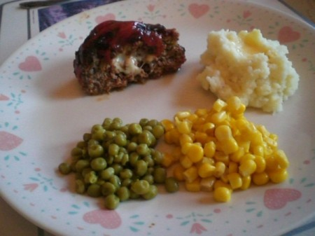 serving on a plate with mashed potatoes and veggies