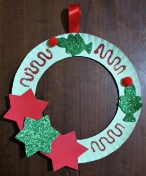 finishes wreath hanging on dark background