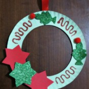 finishes wreath hanging on dark background