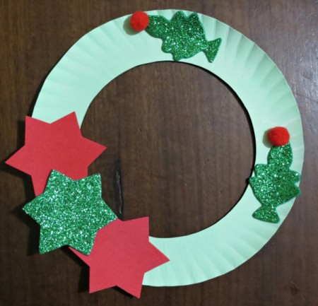 stars and trees with pom poms glued to wreath