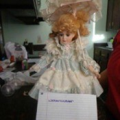 doll with parasol
