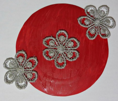 gluing on lace flowers
