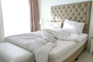 messy bed with white comforter