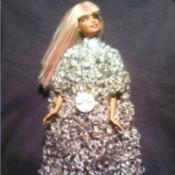 Barbie wearing cloak