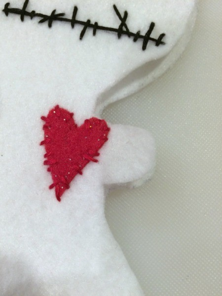 sew heart on doll