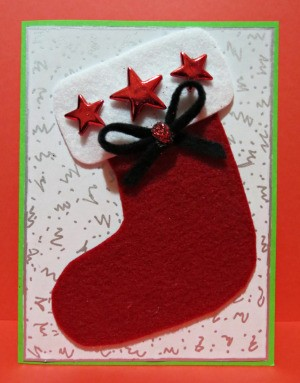 finished card with stars, bow, and glitter