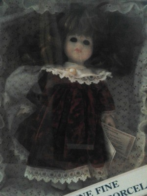 A Dandee porcelain doll in a box.