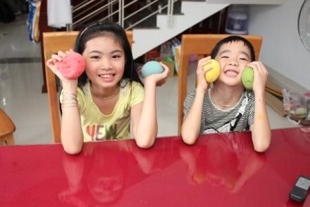 children holding balls of dough