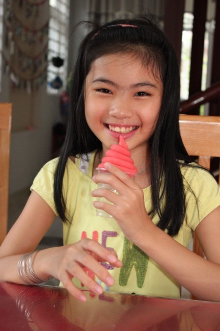 smiling girl with dough twist