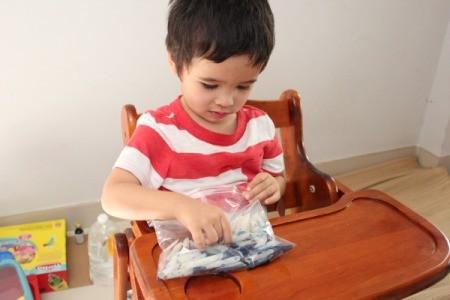 child mixing ingredients